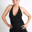Stock Photo: Young blondie womin black dress