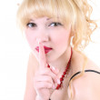 Young girl with her finger over her mouth — Stock Photo