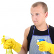 Man with cleaning spray ready for doing housework - Stock Photo