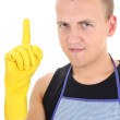 Portrait of man in yellow gloves having an idea - Stock Photo
