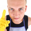 Portrait of funny man in yellow gloves having an idea - Stock Photo