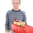 Young mwith gifts — Stock Photo #11792598