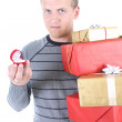 Young man holding gifts — Stock Photo