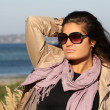 Stock Photo: Portrait of woman in beige autumn coat standing at seaside