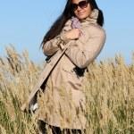 Woman in autumn field — Stock Photo