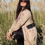 Woman in beige autumn coat posing outdoors — Stock Photo #11792784