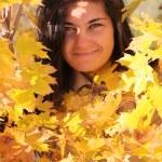 Beautiful woman with yellow maple — Stock Photo