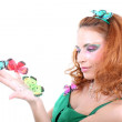 Red-haired woman with butterflies — Stockfoto