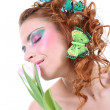 Stock Photo: Red-haired womwith flower and butterflies on her head