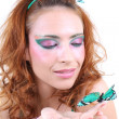 Red-haired woman with butterfly — Stock Photo