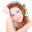 Stock Photo: Red-haired womwith butterflies on her head
