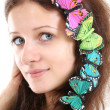 Portrait of beautiful girl with butterflies — Stock Photo