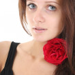 Stock Photo: Portrait of girl with red rose in her hair