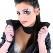 Stock Photo: Young beautiful girl in black leather jacket