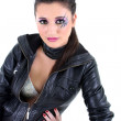 Young beautiful girl in black leather jacket — Stock Photo