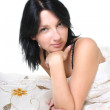 Young woman on bed — Stock Photo