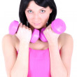 Young healthy girl with pink dumbbell — Stock Photo