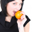 Young beautiful woman biting orange — Stock Photo #11793652