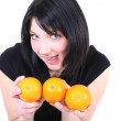 Young beautiful ridiculous womwith oranges — Stock Photo #11793656