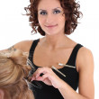 Beautiful hairdresser with client over white — Stock Photo