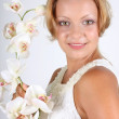Woman with white orchid — Stock Photo