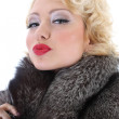 Stock Photo: Blondie womwith fur collar kissing