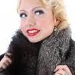 Blondie woman with fur collar dreaming - Stock Photo