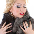 Blondie woman with fur collar dreaming - Stockfoto