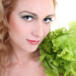 图库照片: Young woman with green salad