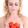 Portrait of young woman with tomatoes — Stock Photo