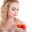 Portrait of young woman with tomatoes — Stock fotografie