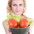 Young woman with green salad an tomatoes — Stock Photo