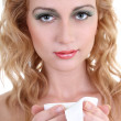 Young woman with mug of coffee over white — Stockfoto