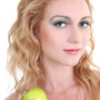 Foto Stock: Young beautiful woman with green apple