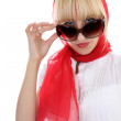 Girl in red correcting sunglasses — Stock Photo #11794340