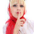 Royalty-Free Stock Photo: Girl in red with finger on lips