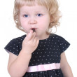 Little girl with chocolate candy — Stock Photo
