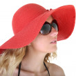 Woman in red hat and sunglasses — Stock fotografie