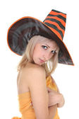 Beautiful blonde in witch hat — Stock Photo