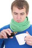 Young man in blue with medicine and cup — Stock Photo