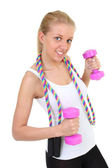 Girl with skipping rope and dumbbells — Stock Photo