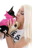 Young woman kissing toy-terrier over white — Stock Photo