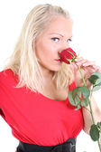 Lady in red with red rose — Stock Photo
