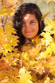 Beautiful woman with yellow maple — Stock Photo