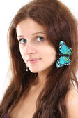 Beautiful girl with butterfly — Stock Photo