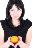 Young beautiful woman with orange — Stockfoto