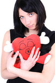 Smiling girl in black with red heart — Stock Photo