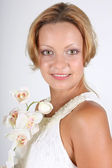 Portrait of woman with white orchid — Stock Photo