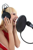 Woman singing over white — Stock Photo