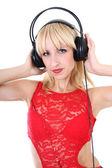 Woman listening music over white — Stock fotografie
